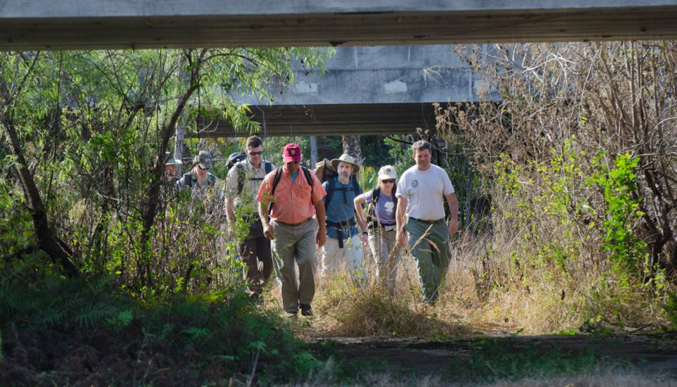 The 2012 Florida Wildlife Corridor Expedition team walks beneath an Interstate 75 wildlife underpass between Picayune Strand State Forest and Florida Panther National Wildlife Refuge. Hosts include FWC lead panther biologist Darrell Land and Panther NWR manager Kevin Godsea. Tom Hoctor from the University of Florida and Laurie Macdonald from Defenders of Wildlife were also present.