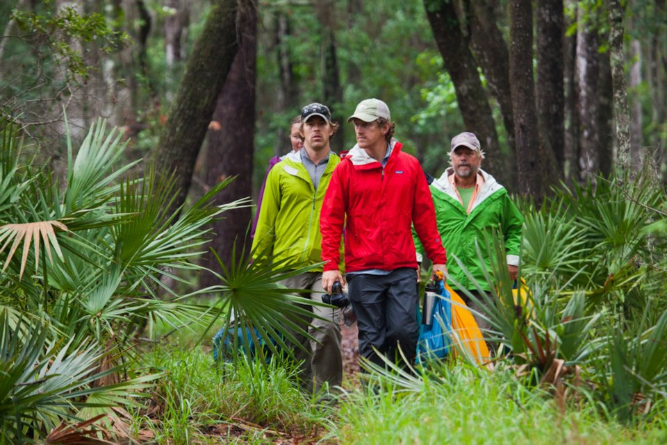 On Earth Day, April 22, day 97 of the expedition, the team breaks camp at Mixon's Hammock and paddles in the rain to a celebration at Stephen Foster State Park inside the Okefenokee National Wildlife Refuge. Florida Wildlife Corridor Expedition. From January 17 through April 25, 2012, a team of explorers including photographer Carlton Ward Jr, cinematographer Elam Stoltzfus, bear biologist Joe Guthrie and conservationist Mallory Lykes Dimmitt, set out to trek 1000 miles in 100 days to showcase the opportunity to protect a connected corridor of natural lands and waters throughout peninsular Florida for the benefit of wildlife and people. Learn more at FloridaWildlifeCorridor.org. Image by Mac Stone.