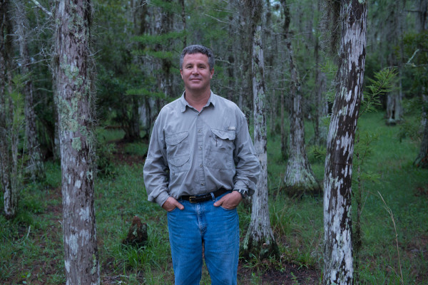 """Carlos Vergara, an owner of Camp Lonesome Ranch which lies within the Big Bend Swamp-Holopaw Ranch, Carlton Ward's Critical Linkage assignment. Carlton explains, """"I really enjoy spending time with landowners and ranchers like Carlos Vergara who are committed to creating a conservation legacy."""""""